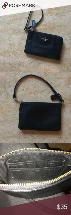 Black Coach Zipper Wallet This is a black Coach wrist wallet that features a zipper closure. Excellent condition with leather slightly broken in. Offers welcome! Coach Bags Clutches & Wristlets