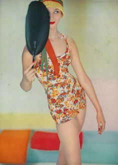 Model wearing a swimsuit by Rose Marie Reid, Vogue, May 1958.