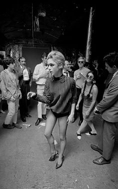 Bob Adelman USA. New York City. 1965. Edie SEDGWICK dances at a party
