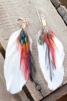 Tropical getaway feather earrings by heidiroland on Etsy. $25.00 USD, via Etsy.