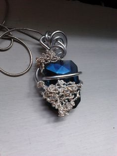 Beautiful hand-made translucent blue glass pendant with silver-plated and aluminium wire now available at Etsy.