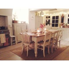Love the kitchen table and chairs. Love the painted furniture.