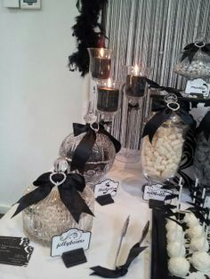 Elegant black & white themed party. I really like the bow decorations on top of the apothecary jars.