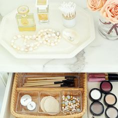 Beauty Station - The bonus counter space offers a home for a pretty ironstone tray to organize jewels and scents. A woven silverware tray fitted with clear plastic containers inside a shallow drawer organizes makeup supplies. A nonslip drawer liner keeps compacts from shifting.