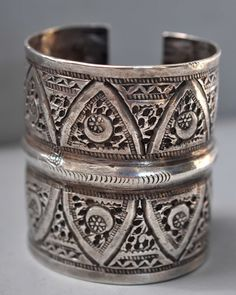 cut through cuff like lace,  really nice workmanship, most likely from Libya . It has several hall marks. Late 19th /or early 20th c