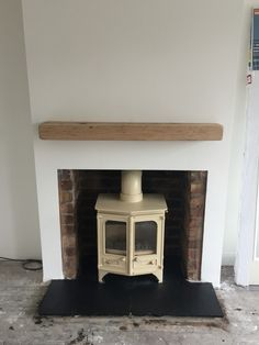Charnwood Country 6 in almond with Reclaimed brick chamber and solid oak beam