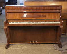 Weinbach upright piano with a mahogany case and cabriole legs from our range of affordable, starter pianos £600. Bid now!