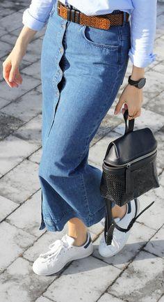 Joyce Croonen is wearing a button front long denim skirt from H&M