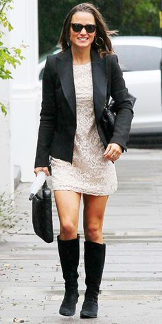 Pippa Middleton in London in a black blazer layered over an ivory lace dress by H&M (available for $34.95 at H&M stores). She paired the look with black boots, gold hoop earrings, and her Knomo laptop carrying case.