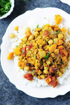 Curried lentils cooked with sweet potatoes, fire-roasted tomatoes chickpeas, this vegan and gluten-free dish is high in protein and big on flavor. Serve it over rice.