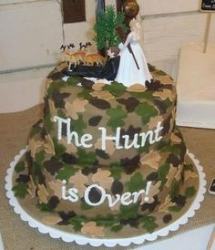 """The Hunt is Over!""  Camo wedding cake."