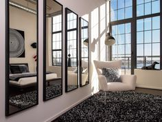 "Model home mirror wall with white walls and large windows.  In collaboration with Italian furniture & designer ""Jesse"""