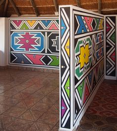 Esther Mahlangu will paint two mural-scale works, which will serve as a gateway to the museum's African Art Gallery. African Logo, African Tribal Patterns, South African Artists, African Tribes, African House, Afrique Art, African Art Paintings, Geometric Painting, Elements Of Art
