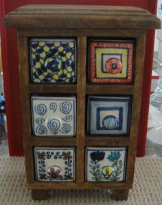 I bought mine at Pier One. Colorful Hand Crafted Spice Tea Jewelry Mini Wood Chest w 6 Porcelain Drawers.