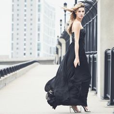 Make an entrance. A floor-length black gown provides effortless glamour and drama.