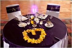 purple and yellow sweetheart table, a heart made out of yellow rose petals, classic purple and yellow reception, classic purple and yellow wedding