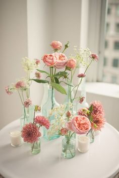 pink floral arrangements in glass bottles, photo by MGB Photo #Centerpieces