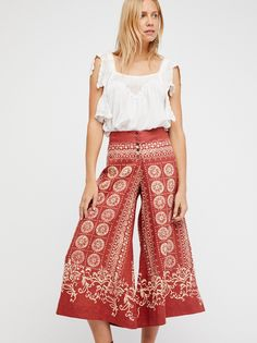 Bali Bandana Pant | Easy linen cropped flares featuring a bandana-inspired print. * Button closures * Semi-sheer fabrication
