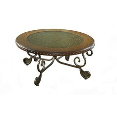 Featuring outstanding scroll work on the supports, this metal table has a beautiful etched top. Also features a rich wood frame and nailhead apron to bring style to your home.