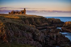 The ruins of Slains Castle atop cliffs looking out to the North Sea in Aberdeenshire, Scotland.