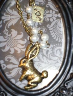 $9.99  Darling Bronze Bunny Necklace Pearls Lace ~ Alice in Wonderland   http://www.nanaluluslinensandhandkerchiefs.com/index.cfm/fa/items.main/parentcat/31996/subcatid/0/id/529986