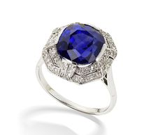 An art deco sapphire and diamond dress ring, circa 1925  The central circular-cut sapphire within an octagonal surround of millegrain-set single-cut diamonds, diamonds approximately 0.70 carat total,