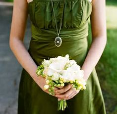white freesia and roses make a perfect nosegay for the bridesmaid