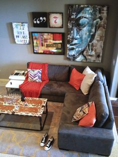 Bachelor Pad |Haute Khuuture Loft living metropolitan apartment interior design decoration decor artwall artwork gallery zen buddha NYC broadway keep calm and carry on grey walls 50 shades of gray custom sectional pop of color tangerine z gallerie west elm wayfair industrial design chic modern contemporary grasscloth wall wallcovering wood statues metal bar metal coffee table round mirror roulette mirror samurai hotel collection ikea