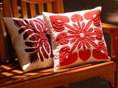 Hawaiian quilt pillows, two different patterns.
