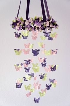 purple, pink, and green butterfly mobile...  um, yes. absolutely adorable.