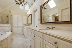Master bathrooms with tons of storage // Dual vanities, built-ins, glass shower and soaker tub, too