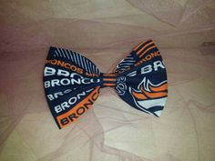 Check out this item in my Etsy shop https://www.etsy.com/listing/245099073/denver-broncos-fabric-bow