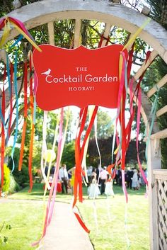 Found on WeddingMeYou.com - Garden Wedding Decoration Ideas with fun guest welcoming gate for cocktail party | Photo by Sherri Diteman