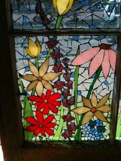 part of a mosaic garden scene window