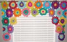 These flower curtains are lovingly hand crocheted in a variety of bright colors…