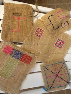 Burlap embroidery is fun, cheap and creative. My daughter and her pal spent hours this week designing their own burlap squares. Requires:  large plastic needle, variety of yarns, burlap and hot glue to finish the edges first so unraveling is minimal. Try colored hot glue for a cool effect!