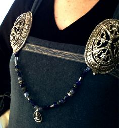 close-up picture of my tortoise brooches, beads and my silver  freya-pendant. the brooches are made after a Norwegian find
