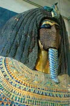Discovered in 1907, Tomb 55 remains one of the most enduring mysteries of the Valley of the Kings. The wooden shrine was clearly made for Tiye (Ankhanaten's mother). The magic bricks bear the name of Ankhanaten. The coffin was made for a woman, but altered for a man and a beard was added. The golden death mask was purposely broken, making identification difficult. DN