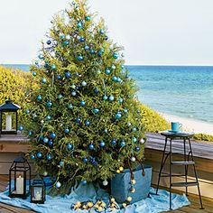 Coastal Christmas on the deck. Love the lantern beside the tree.