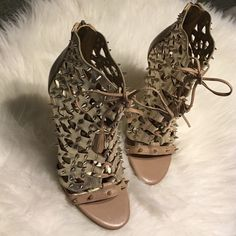 NIB Sam Edelman Gold Metallic Spiked Heels Brand-new in box and never worn Sam Edelman gold metallic cut out leather and suede spiked heels in size 7. Lace upfront detail with zipper closure and back. Heel measures 4.25 inches. These are show stoppers! Sam Edelman Shoes Heels