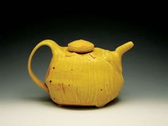 delores fortuna teapot. my favorite ceramic artist! EVER! she is incredibly sweet, too :)