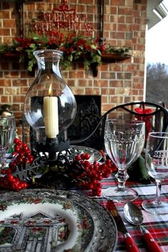 Back Porch Musings: December 2012 - December White table cloth, 2 plaid runners, red berries & hurricane lamp. // Love the black/white/red classic Christmas look.