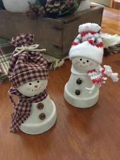 Snowmen made from mini clay pots