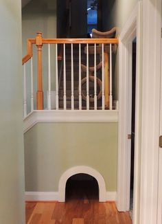 Cat-friendly design idea: This cutout leads to a hidden litter box, which can also be reached from the utility room for cleanup! Find your next #home #plan at www.dongardner.com #pets