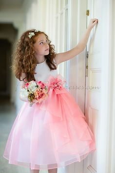 My ideal flower girl dress. Coral taffeta and organza flower girl dress with a beautiful bow from a site my co-worker suggested.