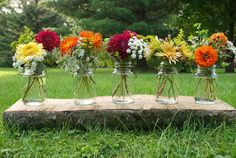mason jars with mums, dahlias and zinnias... all stuff Mary will already have growing.. perfect :)