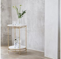 Bar carts are bang on trend at the moment and when you see this, you'll understand why. The retro style gold and marble topped elegant round bar cart table is super stylish and highly practical. A great place to serve drinks from when friends come round, or store your favourite tipples for when the mood strikes.