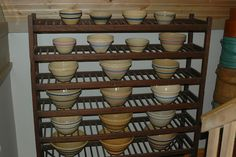 This is my collection of yellow ware bowls.  They are displayed on a shoe rack. I have been collecting for many years.