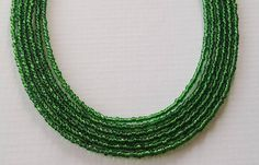 Check out this item in my Etsy shop https://www.etsy.com/listing/493823668/dark-green-seed-bead-necklace-seed-bead