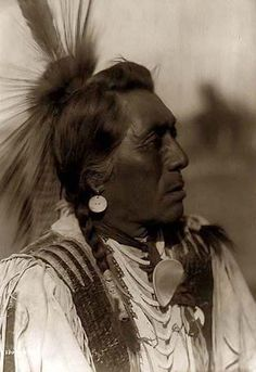 Here we present an historic image of Rabbit Head, a Hidatsa Warrior. It was taken in 1908 by Edward S. Curtis.    The image showsa Hidatsa Indian posed, head and shoulders, facing right.    We have created this collection of images primarily to serve as an easy to access educational tool. Contact curator@old-picture.com.